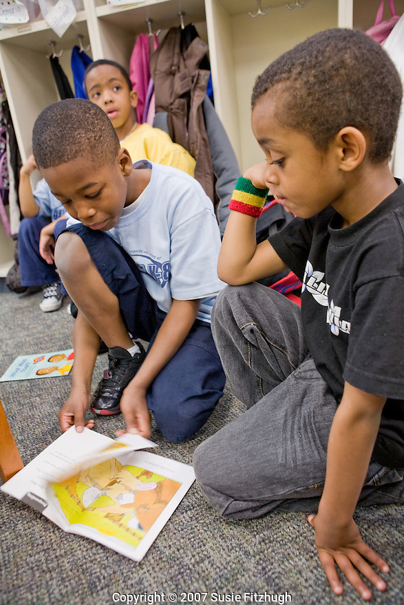 Madrona K-8 School in Seattle, WA: Older students - from first and 2nd grade - read to the kindgartners and help them to understand the stories.
