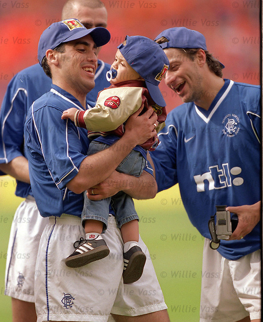 Claudio Reyna and son after the Scottish Cup final 2000