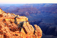 People standing at the edge for a view of Grand Canyon, Arizona at sunrise from the Yavapai Point, in South rim.