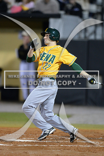 Siena Saints outfielder Dan Swain (22) hits a home run during the season opening game against the Central Florida Knights at Jay Bergman Field on February 14, 2014 in Orlando, Florida.  UCF defeated Siena 8-1.  (Copyright Mike Janes Photography)