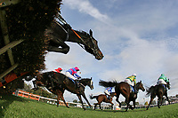 Rider jump the last fence in the Frimstone Handicap Hurdle