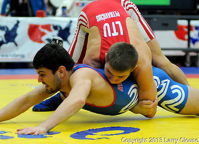 January 26, 2013: Lithuania's, Justin Petravicius (top), and USA's, Dmitry Ryabchinski, during Greco-Roman wrestling action during the Jack Pinto Cup at the United States Olympic Training Center, Colorado Springs, Colorado.  This unique dual format international competition has been named in memory of Jack Pinto, a young USA Wrestling member and one of the shooting victims at Sandy Hook Elementary School, Newtown, CT.
