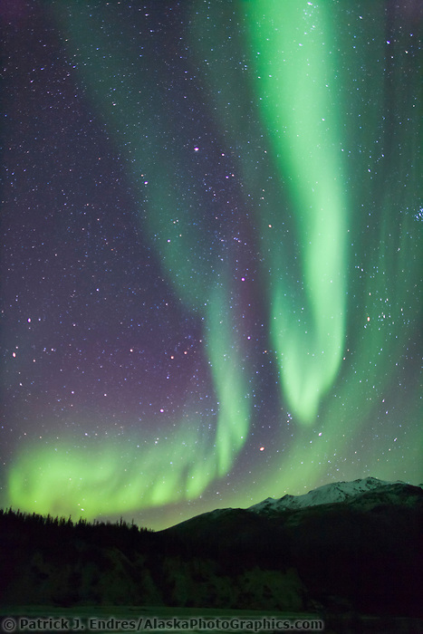 Aurora borealis over the Brooks range mountains near Wiseman, Alaska.