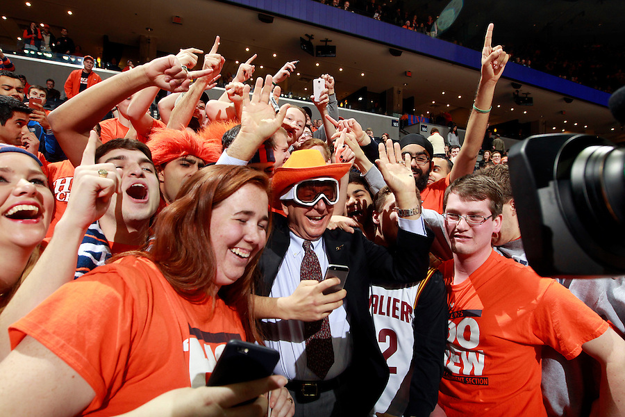 Legendary sportscaster Dick Vitale greets Virginia fans the start of the game against Louisville Saturday Feb. 7, 2015, in Charlottesville, Va. Virginia defeated Louisville  52-47. (Photo/Andrew Shurtleff)