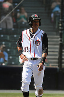 Richmond Flying Squirrels infielder Ehire Adrianza #13 after scoring a run during a game against the Trenton Thunder at The Diamond on May 27, 2012 in Richmond, Virginia. Richmond defeated Trenton by the score of 5-2. (Robert Gurganus/Four Seam Images)
