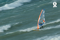 Elevated view of man windsurfing in sea, motion blur (Licence this image exclusively with Getty: http://www.gettyimages.com/detail/74583317 )