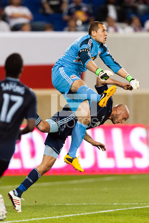 New York Red Bulls goalkeeper Luis Robles (31) collides with Aurelien Collin (78) of Sporting Kansas City. Sporting Kansas City defeated the New York Red Bulls 1-0 during a Major League Soccer (MLS) match at Red Bull Arena in Harrison, NJ, on April 17, 2013.