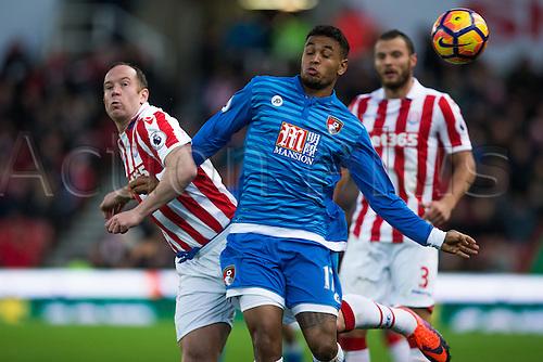19.11.2016. Bet365 Stadium, Stoke, England. Premier League Football. Stoke City versus AFC Bournemouth. Bournemouth midfielder Joshua King avoids Stoke City midfielder Charlie Adam.