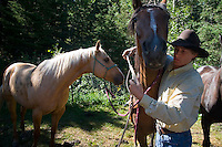 Mountain View, Alberta, Canada, July 2008. Cowboy Calin Duce prepares our horses. Rancher Dan Nelson takes us on a horse back trail ride in the hills connecting the Albertan prairie with the mountains of Waterton National Park. Photo by Frits Meyst/Adventure4ever.com