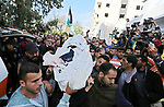 """Palestinians carry the body of a fisherman Ismail Abu Riala, 18, who was shot dead by Israeli Naval forces on February 14, after Israeli High Court decided to release his body outside al-Shifa hospital, in Gaza City on March 14, 2018. A spokeswoman for the Israeli army said the boat """"deviated from the designated fishing zone in the northern Gaza Strip. """"Naval forces called on the boat to halt, then fired warning shots in the air before shooting toward it when the three people on board did not stop, the spokeswoman said. Photo by Ashraf Amra"""
