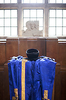 Gown and mortarboard set out before the degree ceremony at Guildford Cathedral for the University of Surrey.
