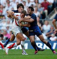 Photo: Richard Lane/Richard Lane Photography..England v France. Rugby World Cup 2007 Warm-up Match. 11/08/2007. .England's Olly Barkley is tackled by France's David Skrela (lt) and David Marty.