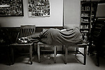 pvc070114g/7-1-14/asec.  An unidentified man sleeps on three wooden chairs inside St. Martin's Hospitality Center Monday June 30, 2014.  (Pat Vasquez-Cunningham/Journal)