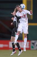 Chicago Fire forward Calen Carr (3) jumps to head the ball against DC United midfielder Brian Carroll (16). The Chicago Fire defeated DC United 3-2, Sunday, October 15, 2006, at RFK Stadium.