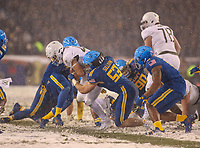 Philadelphia, PA - December 9, 2017:   Navy Midshipmen linebacker Hudson Sullivan (53) tackles Army Black Knights running back Andy Davidson (40) during the 118th game between Army vs Navy at Lincoln Financial Field in Philadelphia, PA. (Photo by Elliott Brown/Media Images International)
