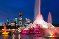 Buckingham Fountain glows at night with the last ambient light turning the sky an ultramarine blue, Chicago, Illlinois