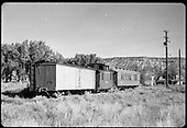 RGS refrigerator car #2101, caboose #0400 &amp; outfit coach #0260 at Ridgway with D&amp;RGW depot in background.<br /> RGS  Ridgway, CO  ca. 1955