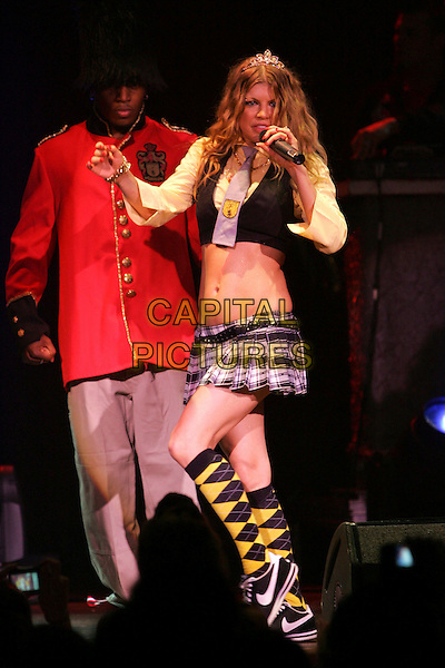 FERGIE.Performs live during her Verizon VIP Tour held at The HOB Anaheim in Anaheim, California, USA..July 17th, 2007 .black eyed peas Stacy Ferguson stage concert live gig music performance full length microphone tiara singing   singing black vest cropped belly stomach midriff kilt plaid tartan skirt guard argyle knee high socks  .CAP/DVS.©Debbie VanStory/Capital Pictures