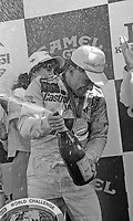 Price Cobb celebrates with champagne in victory lane after driving his Castrol Racing Jaguar XJR-10 to victory in the IMSA GTP/Lights race at the Florida State Fairgrounds in Tampa, FL, October 1, 1989.  (Photo by Brian Cleary/www.bcpix.com)