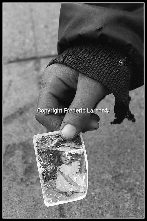 Shawn, a young homeless man from New York displays a photograph of his daughter, Emily Ann, Age 1 (now age 4) which he hasn't seen in years since he left for San Francisco.