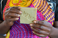 Africa, DRC, Democratic Republic of the Congo, South Kivu, Kamanyola. Women for Women project. WFW co-op and lifeskills training. Women making medicinal soap for sale.