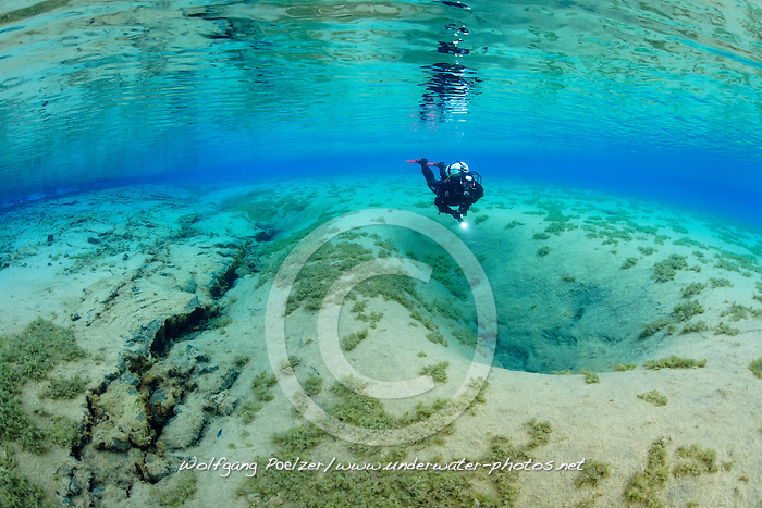 Nesgja, Taucher in glasklarer suesswasser Lagune in Nesgja, scuba diver in crystal clear fresh water in Nesgau - crack, Akureyri, Nord Island, North Iceland, MR yes