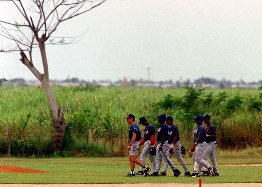 Academy players follow their coach in a learning experience that stretches beyond baseball.