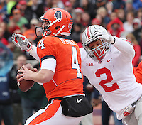Ohio State Buckeye linebacker Ryan Shazier bears down on Illinois Fighting Illini quarterback Reilly O'Toole (4) for a sack at Memorial Stadium in Champaign, Illinois on November 16, 2013.  (Chris Russell/Dispatch Photo)