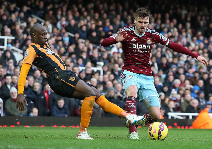 Hull City's Sone Aluko under pressure from  West Ham United's Carl Jenkinson<br /> Photographer Kieran Galvin/CameraSport<br /> <br /> Football - Barclays Premiership - West Ham United v Hull City - Sunday 18th January 2015 - Boleyn Ground - London<br /> <br /> &copy; CameraSport - 43 Linden Ave. Countesthorpe. Leicester. England. LE8 5PG - Tel: +44 (0) 116 277 4147 - admin@camerasport.com - www.camerasport.com