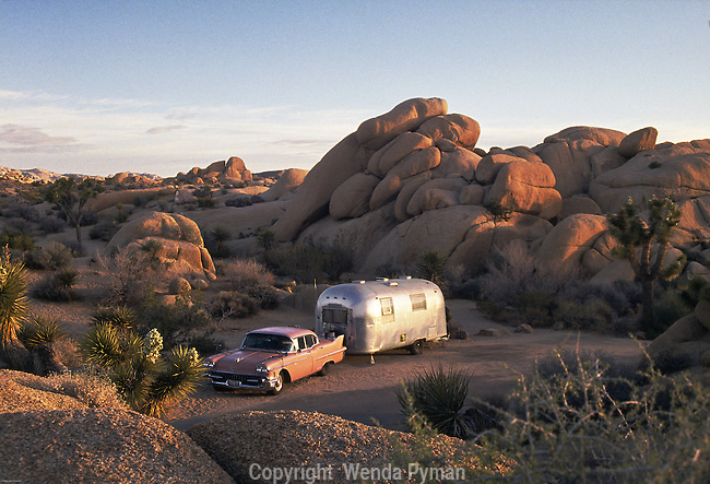 An old pink cadillac and Airstream trailer sits in the Jumbo Rocks campground.