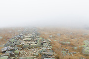 Foggy conditions along the Appalachian Trail (Franconia Ridge Trail) near Mount Lafayette in the White Mountains, New Hampshire during the autumn months.
