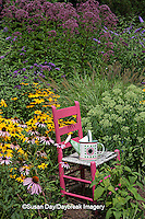 63821-23013 Pink chair and watering can birdhouse in flower garden, Marion Co., IL