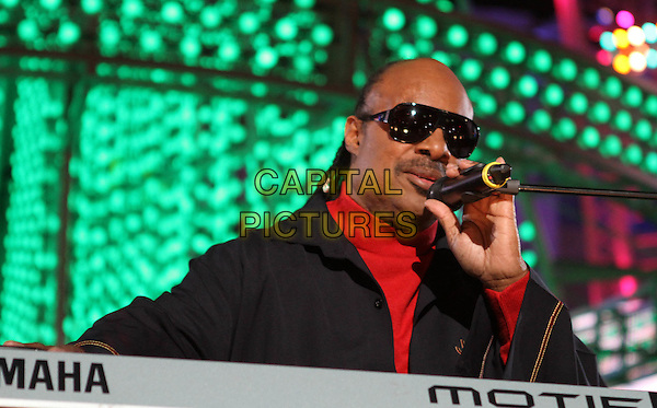 STEVIE WONDER .The Holiday Tree Lighting At L.A. Live & Opening Of L.A. Kings Holiday Ice held At L.A Live,  Los Angeles, CA, USA, .4th December 2010..music concert live on stage gig half length sunglasses black red microphone singing polo neck .CAP/ADM/KB.©Kevan Brooks/AdMedia/Capital Pictures.