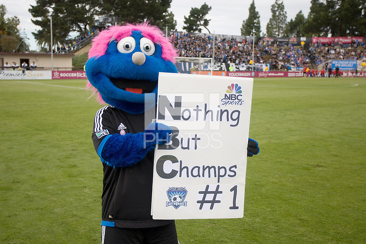"Earthquakes mascot Q holds up a sign says ""Nothing But Champs #1"" before the game between Earthquakes and Galaxy at Buck Shaw Stadium in Santa Clara, California on October 21st, 2012.  San Jose Earthquakes and Los Angeles Galaxy tied at 2-2."