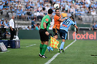 31st January 2020; Netstrata Jubilee Stadium, Sydney, New South Wales, Australia; A League Football, Sydney FC versus Brisbane Roar; Jack Hingert of Brisbane Roar tries to keep the ball in play as coach Steve Corica of Sydney watches on