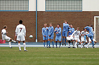 SMU's Jay Needham (14) plays a free kick into a massive wall of defenders and teammates. Southern Methodist University defeated the University of North Carolina 3-2 in double overtime at Fetzer Field in Chapel Hill, North Carolina, Saturday, December 3, 2005.