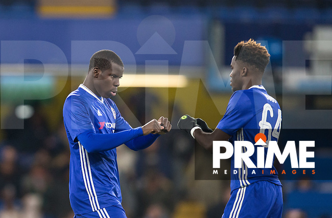 Kurt Zouma of Chelsea fist pump with Ike Ugbo of Chelsea during the The Checkatrade Trophy match between Chelsea U23 and Oxford United at Stamford Bridge, London, England on 8 November 2016. Photo by Andy Rowland.