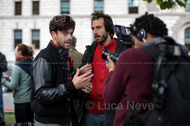 (from L to R) Jolyon Rubinstein &amp; George Barda.<br /> <br /> Day IX - 25.10.2014<br /> <br /> London 17-26.10.2014. A day at the Parliament Square Occupy Democracy Camp in London. Protesters have been camping in Parliament Square since the 17th of October and they will leave on Sunday the 26th. Since the beginning of the direct action protesters have been battling with the MET Police and the Greater London Authority's Heritage Wardens (provided under private contract by AOS Security) over the specific bylaw which applies to a designated area immediately surrounding and including Parliament Square and which bans sleeping equipment. Several people have been arrested, including the Green Party's Baroness Jenny Jones, member of the London Assembly who was later &quot;de-arrested&quot;. In the meantime, numerous celebrities, politicians, experts, activists, and members of the public met for conferences and debates about various topics, from democracy to climate change, to the economic crisis, to corruption, to poetry and many more.<br /> <br /> For more information please click here: http://occupydemocracy.org.uk/ &amp; http://on.fb.me/12tuv79