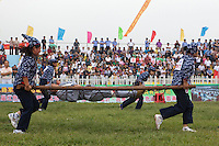 Female competitors dressed as revolutionary volunteers carry 'wounded soldiers' on stretchers in the 'Rescue the Wounded Soldier' event of the Red Games. Held in Junan County, this sporting event is a nostalgic tribute to the communist era.