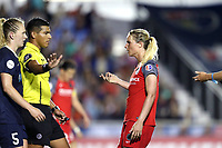 Cary, NC - Saturday April 22, 2017: Referee Victor Rivas steps between Amandine Henry (right) and Samantha Mewis (5) during a regular season National Women's Soccer League (NWSL) match between the North Carolina Courage and the Portland Thorns FC at Sahlen's Stadium at WakeMed Soccer Park.