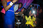"KAMPALA, UGANDA – DECEMBER 18: Partygoers attend an ""Arab Money"" themed party at a club in Kampala, Uganda on December 18, 2014. Wealthy people from Uganda and neighbouring countries flew in to attend the upmarket party. (Photo by: Per-Anders Pettersson)"