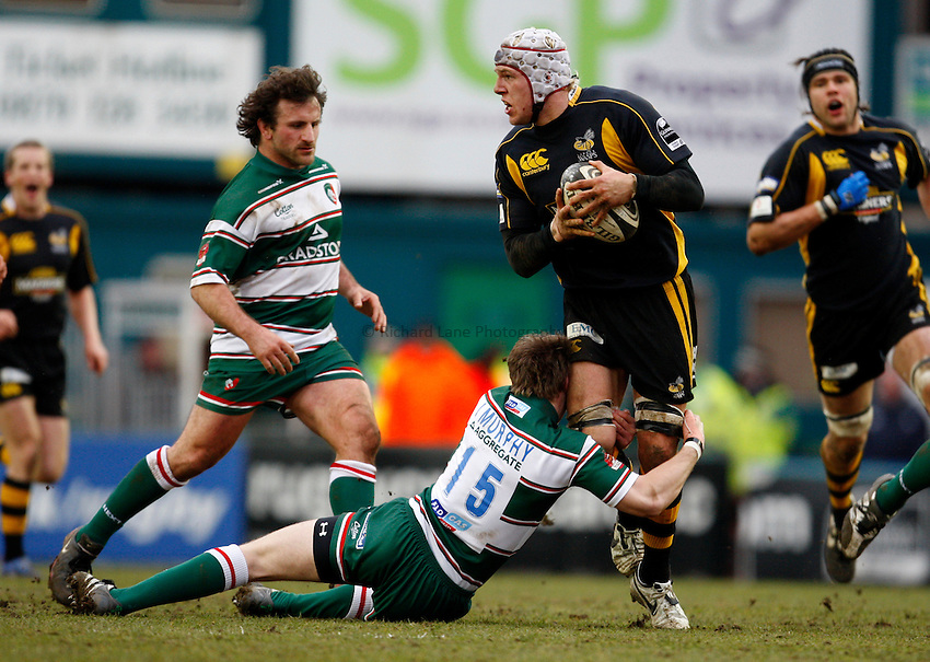 Photo: Richard Lane/Richard Lane Photography..Leicester Tigers v London Wasps. Guinness Premiership. 29/03/2008. Wasps' James Haskell looks to pass out of the tackle by Tigers' Johnny Murphy.