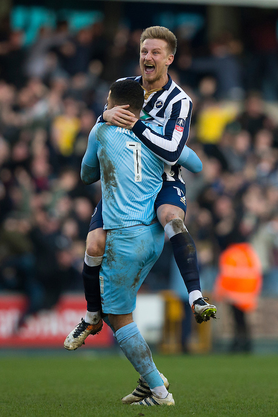 Millwall's Byron Webster (right) and Jordan Archer celebrates their sides goal<br /> <br /> Photographer Craig Mercer/CameraSport<br /> <br /> Emirates FA Cup Fifth Round - Millwall v Leicester City - Saturday 18th February 2017 - The Den - London<br />  <br /> World Copyright &copy; 2017 CameraSport. All rights reserved. 43 Linden Ave. Countesthorpe. Leicester. England. LE8 5PG - Tel: +44 (0) 116 277 4147 - admin@camerasport.com - www.camerasport.com