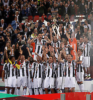 Calcio, finale Tim Cup: Milan vs Juventus. Roma, stadio Olimpico, 21 maggio 2016.<br /> Juventus&rsquo;s Leonardo Bonucci holds up the trophy at the end of the Italian Cup final football match between AC Milan and Juventus at Rome's Olympic stadium, 21 May 2016. Juventus won 1-0 in the extra time.<br /> UPDATE IMAGES PRESS/Isabella Bonotto