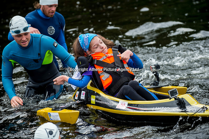 COPY BY TOM BEDFORD<br /> Sunday 26 June 2016<br /> Pictured: Poppy is taken into the water by the team <br /> Re: A very special father-and-daughter team have tackled the Cardiff Triathlon.<br /> Poppy Jones, 11, who will be competing alongside dad Rob Jones, wants to win the event.<br /> And she's not going to let the fact that she has quadriplegic cerebral palsy , which means she can't sit, stand, roll or support herself, and chronic lung disease stop her.<br /> She will be by Rob's side every step of the way thanks to a cutting-edge wheelchair and boat – for Rob to push or pull – designed especially for the event, which sees participants take part in a swim across Cardiff Bay , a run and a bike ride.