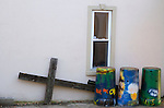 Behind First Christian Church a cross lays on its side behind several brightly decorated trash cans, almost as though it been abandoned. Photo by Alex Holt