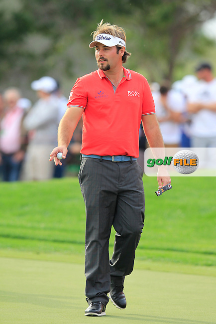 Victor Dubuisson (FRA) on the 17th green during Sunday's Final Round of the Abu Dhabi HSBC Golf Championship 2015 held at the Abu Dhabi Golf Course, United Arab Emirates. 18th January 2015.<br /> Picture: Eoin Clarke www.golffile.ie