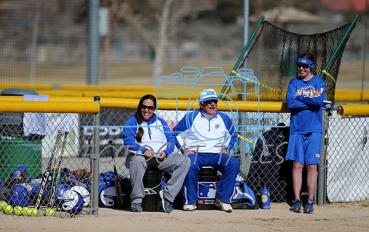 Western Nevada College's coaches, from left, Leah Wentworth, Lloyd Capra and Rosie Contri watch the action in a college softball game against Colorado Northwestern on Friday, Feb. 22, 2013, in Carson City, Nev..Photo by Cathleen Allison