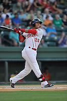 Second baseman Yoan Moncada (24) of the Greenville Drive bats in a game against the Greensboro Grasshoppers on Tuesday, August 25, 2015, at Fluor Field at the West End in Greenville, South Carolina. The Cuban-born 19-year-old Red Sox signee has been ranked the No. 1 international prospect in baseball by Baseball America. Greensboro won, 3-2. (Tom Priddy/Four Seam Images)
