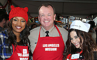 Los Angeles, CA - NOVEMBER 23: Garcelle Beauvais, Sheriff Jim McDonnell, Brooke Lewis, At Los Angeles Mission Thanksgiving Meal For The Homeless At Los Angeles Mission, California on November 23, 2016. Credit: Faye Sadou/MediaPunch